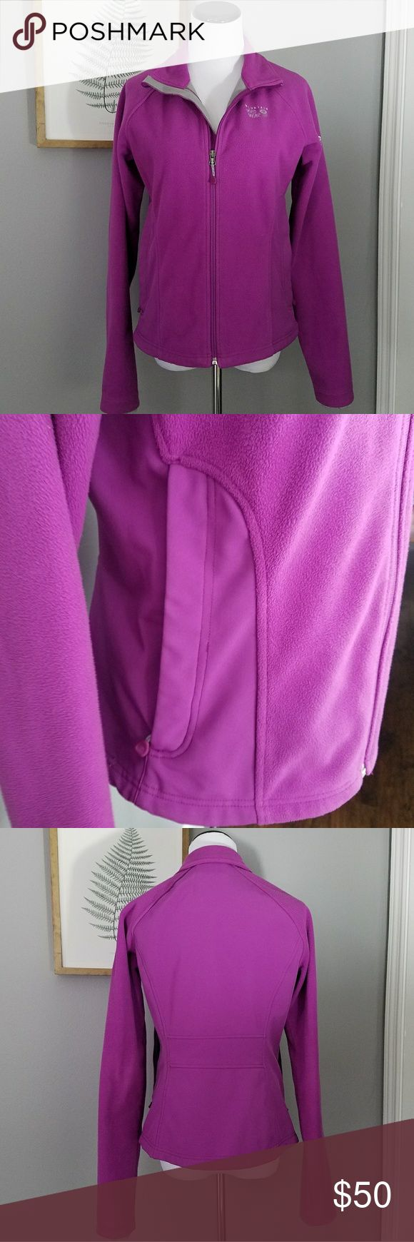 Mountain Hardwear Windstopper Purple Fleece Jacket Light purple fleece jacket with windproof material. Water resistant exterior. Very warm without the bulk of a full coat. Length is 23 in. 18 inch pit to pit. Sleeve length from armpit is 23.5 in. Good preowned condition. Mountain Hardwear Jackets & Coats