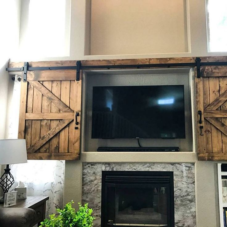 Image result for pictures of stone fireplace with sliding barn door over televisions
