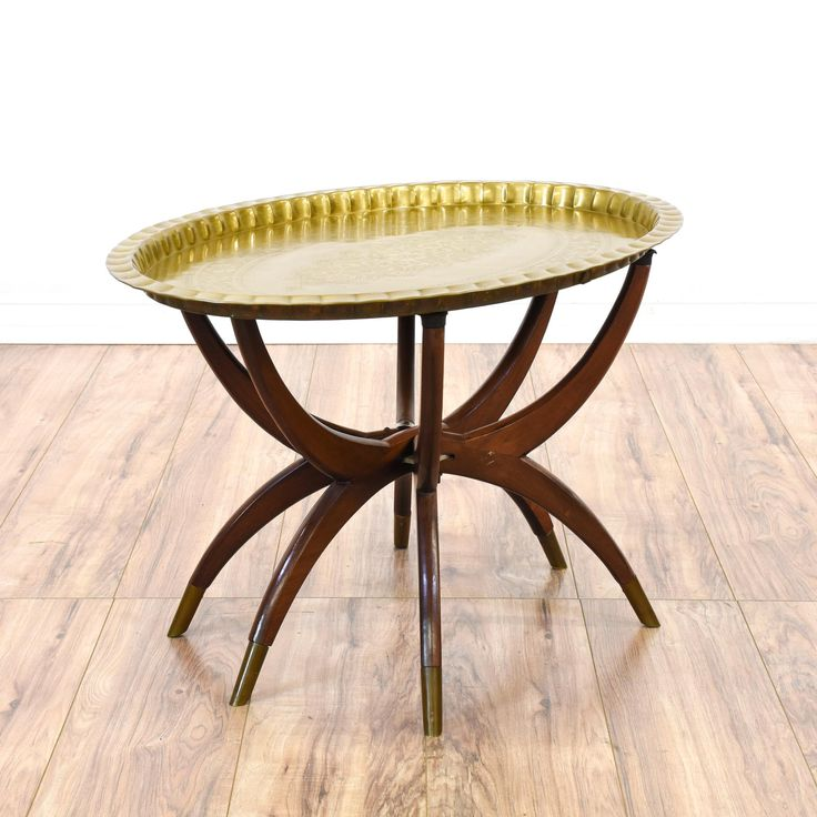 This tray table is featured in a solid wood with a glossy cherry and polished brass finish. This mid century modern boho table has paisley designs, spider legs and brass-tipped feet. Perfect for serving snacks! #midcenturymodern #tables #coffeetable #sandiegovintage #vintagefurniture