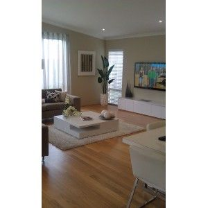 BlackButt floors, white skirts (walls a bit too dark), white furniture, grey couch