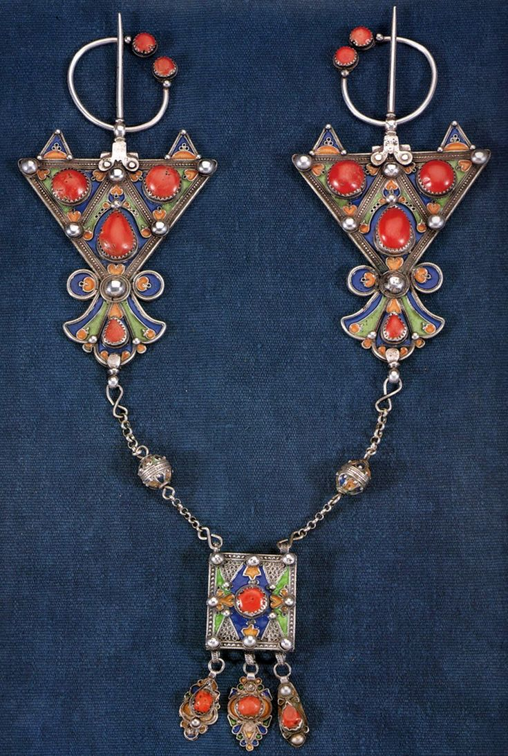 Algeria | Pair of Fibulae ~ A Kabyle woman's set of shoulder brooches | Silver decorated with enamel and coral cabochons.