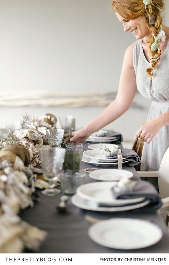 Woman setting table for Christmas | beach inspiration | Photography by Christine Meintjies