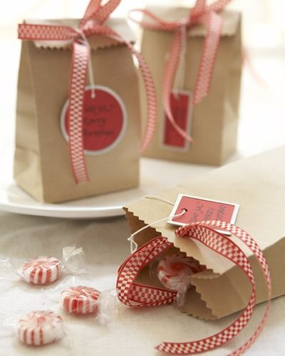 """Small brown paper bags chock full of peppermints and dressed with spunky ribbons make thoughtful give-away gifts. These tags are emblazoned with the words God Jul (""""Merry Christmas"""" in Swedish), but feel free to add your favorite holiday sentiments.sentiments."""