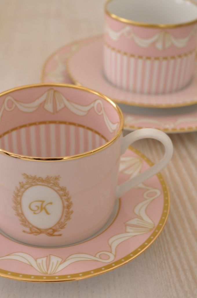 Pink and gold tea cups and saucers