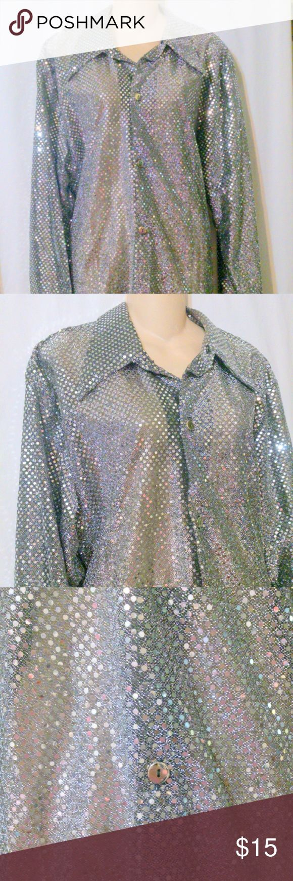 "Vintage 1970s CHARADES Silver Metallic Blouse? This vintage blouse is made by Charades and is a size large. The blouse is done in a polyester metallic silver disc design with a button front. Measurements are: Bust 48"", sleeves 24"", length 30"". In excellent condition! Charade's Tops Blouses"