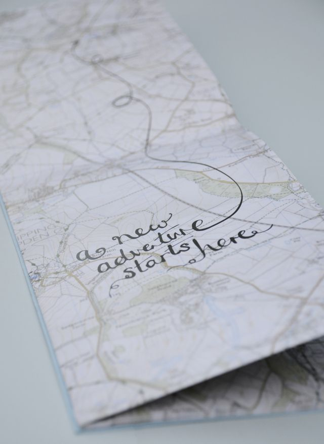I like the use of the map where their wedding was to take place being incorporated with hand lettering.