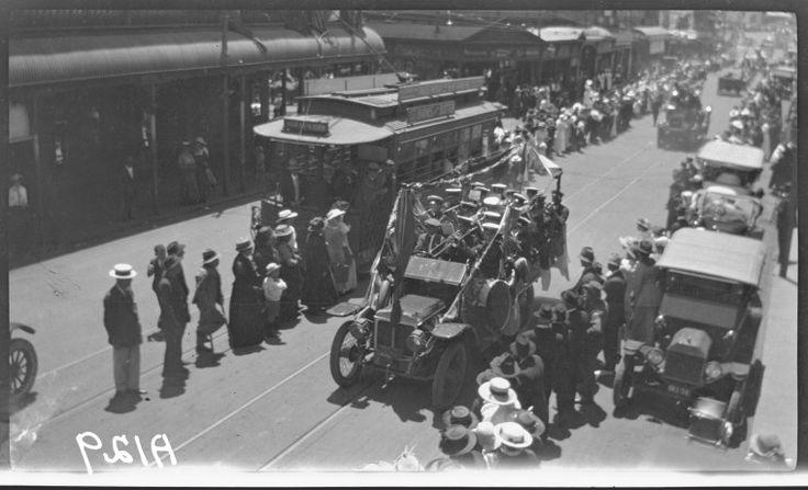 304231PD: Band playing, Red Cross procession, Barrack Street, Perth, 1917. http://purl.slwa.wa.gov.au/slwa_b3800044_1
