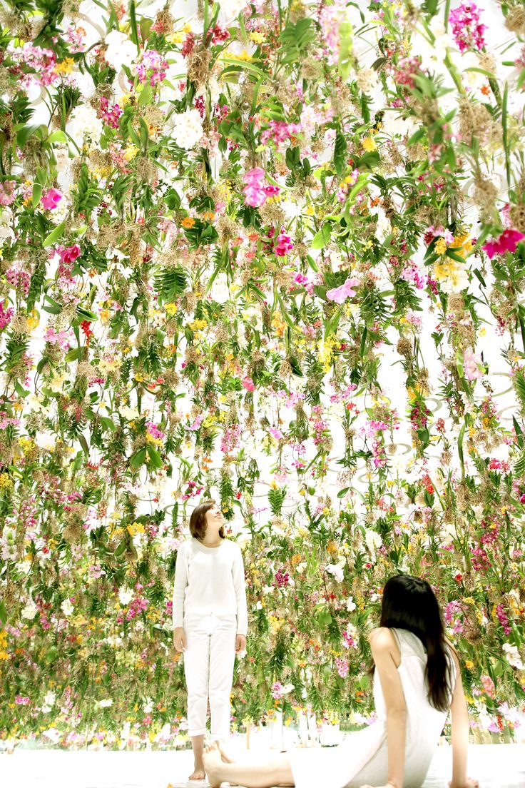 Floating Flower Garden. As part of their large-scale exhibition at Miraikan in Tokyo, TeamLab has created a fully-immersive installation of interactive flowers. 2300 flowers, to be exact, are suspended in a room that responds to the movement of visitors as they enter and walk through the forest of floating flowers.