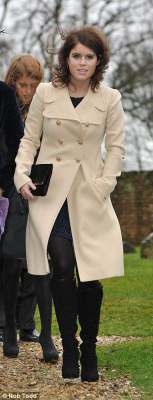 Bracing wind: Princess Eugenie braved the wind as she left the wedding wearing a knee-length cream overcoat