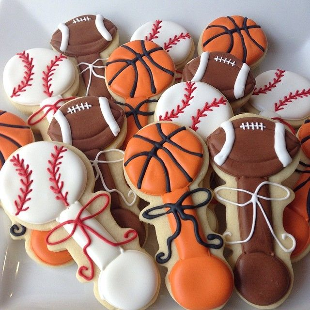 Super cute sports baby shower cookies. Find baby rattle here https://cookiecutter.com/baby-rattle-cookie-cutter.htm                                                                                                                                                      More