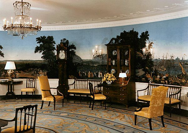A dining room with Zuber wallpaper similar to that in  the White House Diplomatic Room shown here.