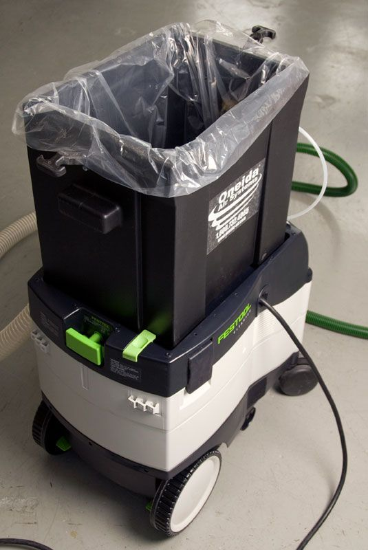 Oneida Ultimate Dust Deputy (UDD) - The Oneida UDD integrates with Festool dust extractors but it can be used with any shop vacuum system. It is especially useful for shop vacuums with a grounded inlet and industrial applications requiring conductive components. Not every vacuum has a grounded inlet so you should review your shop vacuum's owner's manual for more information on it's grounding features.