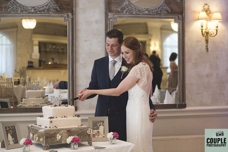Th newlyweds cut their wedding cake. Weddings at Conyngham Arms Hotel, Slane, by Couple Photography.