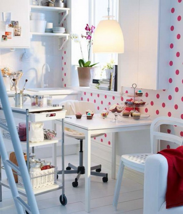 Tiny red and white Ikea kitchen.