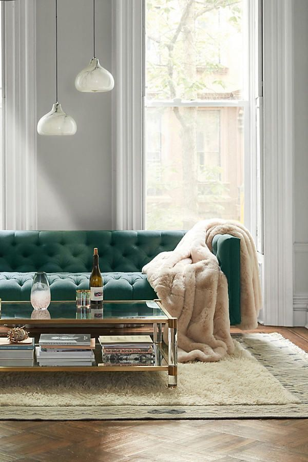 Tis the season for warm and cozy home decor. Velvet tufted sofa and fur blanket.