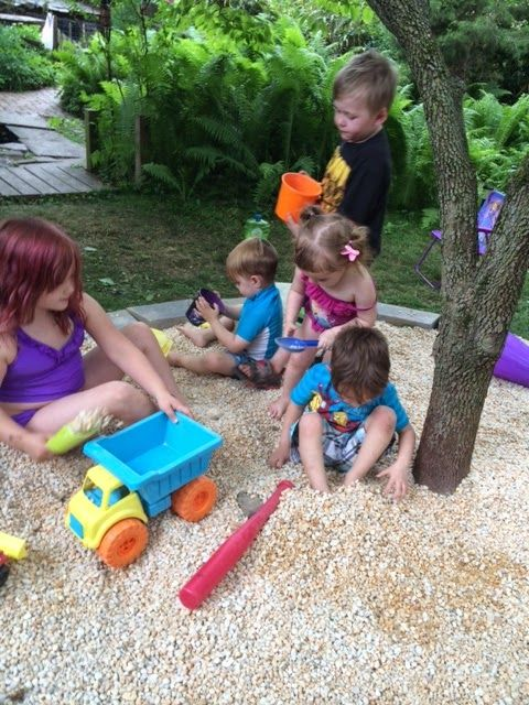 gravel pit for kids! this is a great idea for kids to play in! shade and gravel for summer fun.