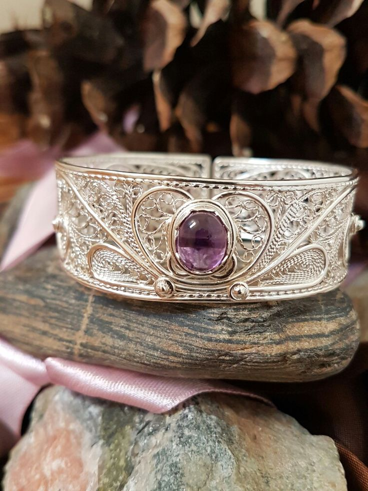 Handcrafted sterling silver filigree and amethyst bracelet.  Haute Wired Jewelry