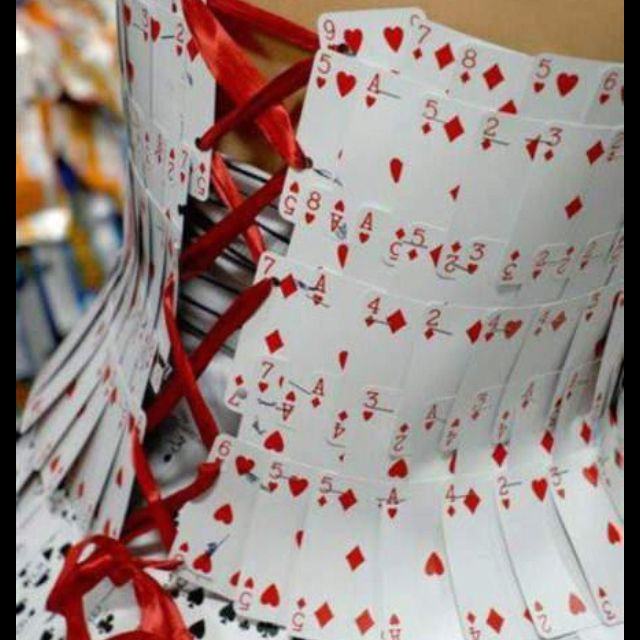 She stapled the cards and made a lace-up back. That is a lot prettier than sewing the cards like I tried for a different project.