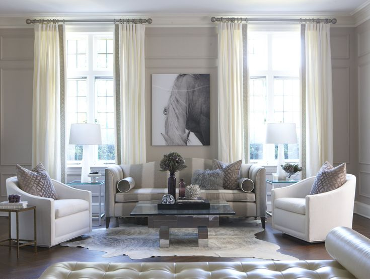 Love the striped sofa in this living room by Erin Gates Design