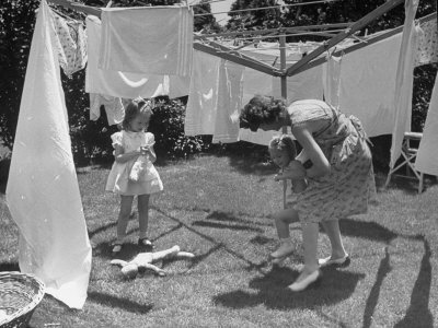 Suburban Mother Playing with Her Two Daughters While Hanging Laundry in Backyard by Alfred Eisenstaedt. Premium photographic print from the LIFE collection at Art.com.