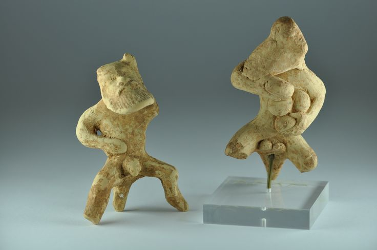 Greek corinthian terracotta satyr, Greek, Corinth, mid 5th century B.C. Greek corinthian terracotta satyrs, one holding loaves of bread, satyrs were bearded male figures with a tail and genitals, 8.5 cm high max. Private collection