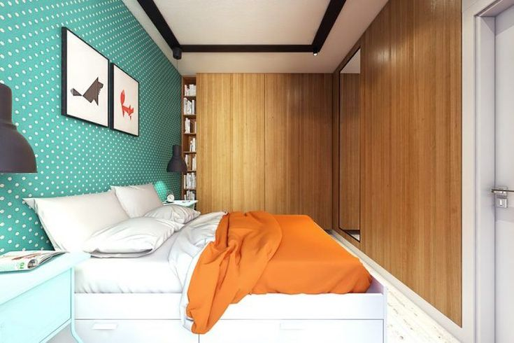 small bedroom with green accent wall