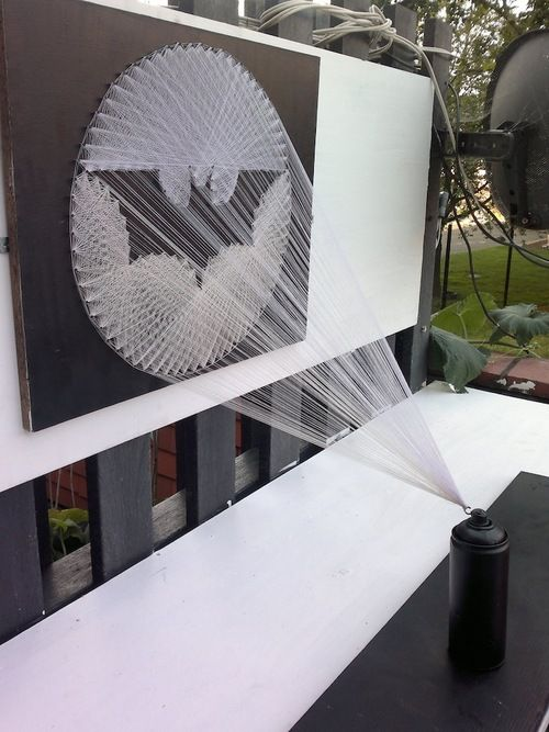 This awesome work of three-dimensional art, that tickles our fancy both as fans of Batman and graffiti, was created by a talented artist named Perspicere. Entitled BATMAN, the sculpture depicts the projection of the unmistakable Bat-signal as threads of white string shooting out of a black can of spray paint.