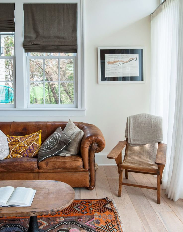 This whole house is utterly beautiful. Modern, simple base with bohemian accessories. Perfect!                               Traditional living room with leather sofa and ethnic accents