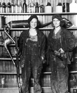 There is not a fast car in the frame, but how can you doubt that they had one? Sisters Guarding Family Moonshine Business --  Florence Friermuth and Susie Friermuth Doffing pose after they were arrested for moonshining. The sisters guarded stills on their family's farm near Saint Paul, Minnesota, during Prohibition.