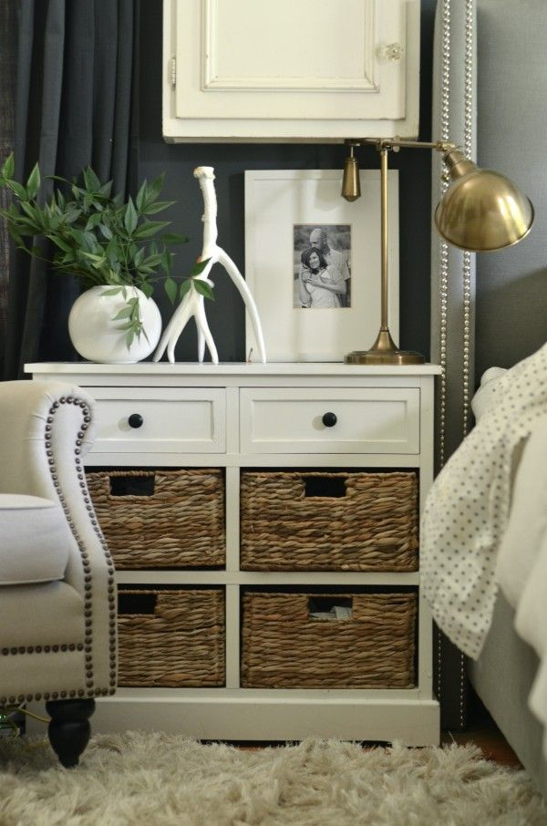 love the white branch next to the round vase as decoration on the nightstand. The brass lamp looks nice as accent.