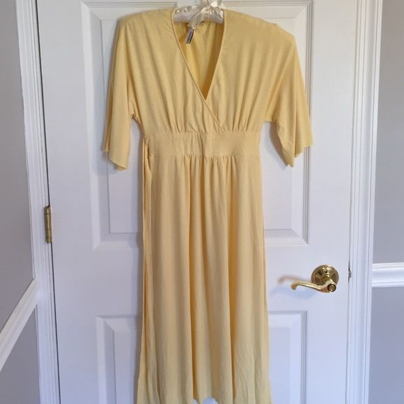 Perfect Spring/Summer Michael Stars Yellow Dress 💛Comfortable Dress by Michael Stars in a beautiful pale yellow. Only worn a few times and in great condition. Size 1. V-neck style with wide sleeves that fall around the elbow. Band around the middle of dress with a tie in back. Viscose/spandex blend. No rips or tears. Such a pretty dress!💛 Michael Stars Dresses