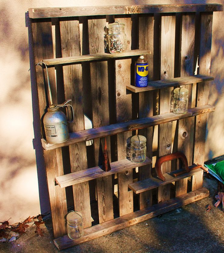 Pallet shelf  Would go great in a barn/garage or even a country/rustic kitchen. Holds books, picture frames, spices, tools, whatever you want to put on it and it's wall mountable. Made completely of recycled pallet wood.
