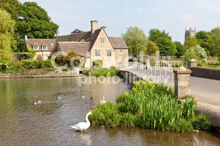 An old mill beside the River Coln in the Cotswold town of Fairford, Gloucestershire.