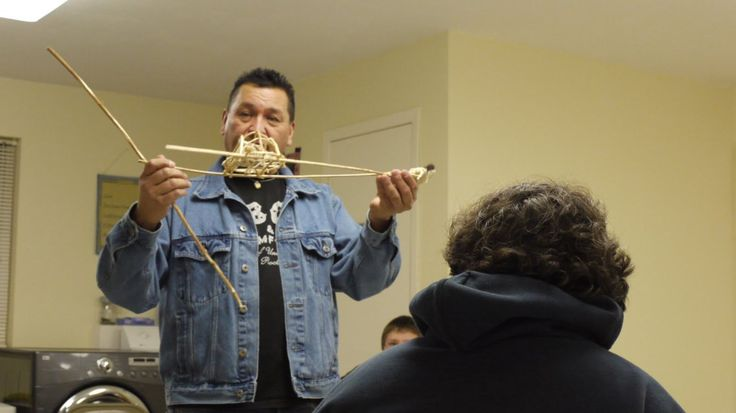 Lakota Artist-Mike Marshall showing a miniature travois to students