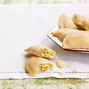 Breakfast Empanadas - Quiche Lorraine by another name, these handheld breakfast pastries are stuffed with eggs, nutty Gruyère cheese, and lots of smoky bacon.