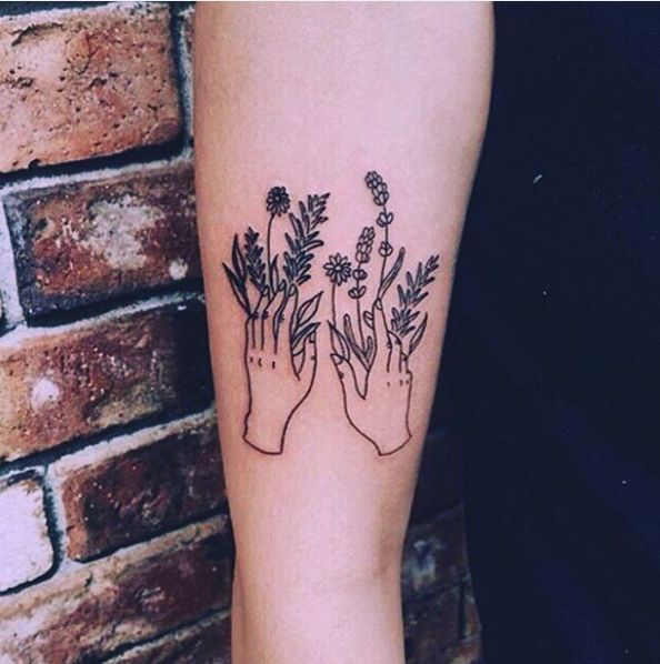These hands with flower powers. | 31 Stunning Floral Tattoos To Get You Ready For Spring