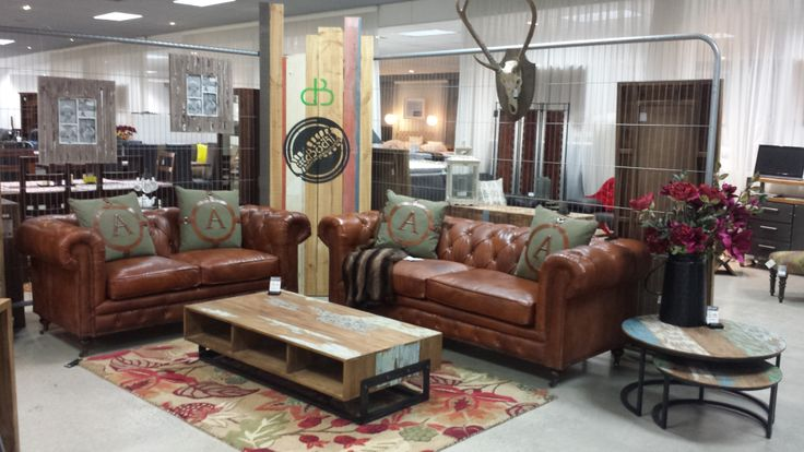 Fine collection  Lounge suite artsome chesterfield 3 seater and 2 seater 100% aneline leather Pictured with occasional pieces from dbodhi