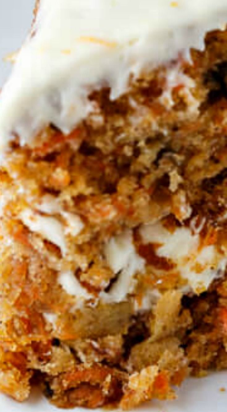 Pineapple Carrot cake with Orange Cream Cheese Frosting ~ Moist carrot cake layers infused with pineapple and frosting with a sweet, tangy orange cream cheese.