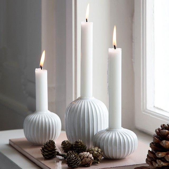The modern candle holder from the Hammershøi range is designed by Hans-Christian Bauer and inspired by Svend Hammershøi, who worked as an artist at Kähler's old workshop.