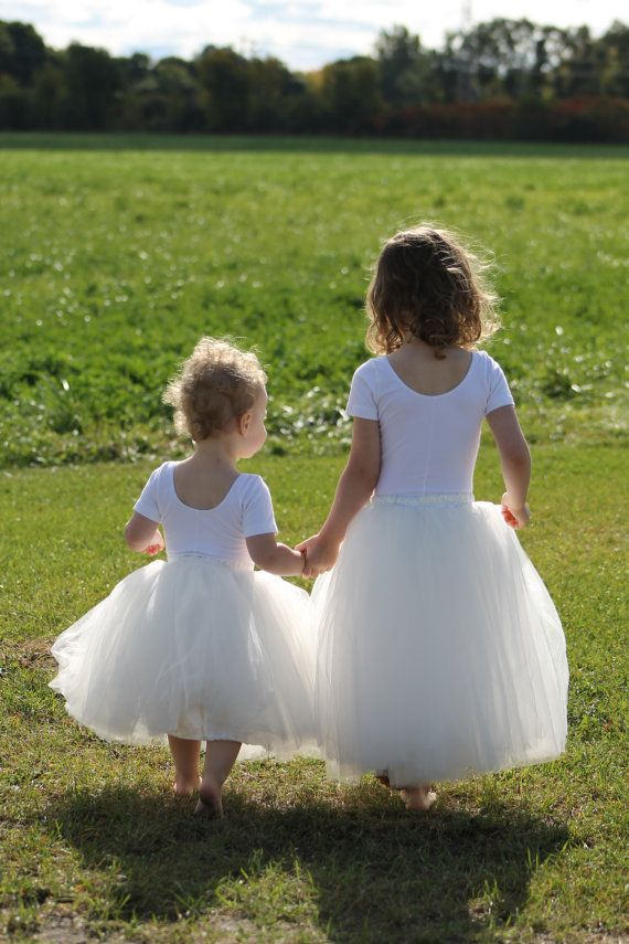 Stunning long sewn (not tied) tulle skirt for your little princess. Skirt is made w/ layers of the highest quality pure white tulle, fully lined with satin, has an elastic waist, and a satin sash. I have paired this stunning couture quality skirt with a simple white leotard (NOT included). This is an ankle length (depending on her height) skirt. This listing is for the skirt with sash only.
