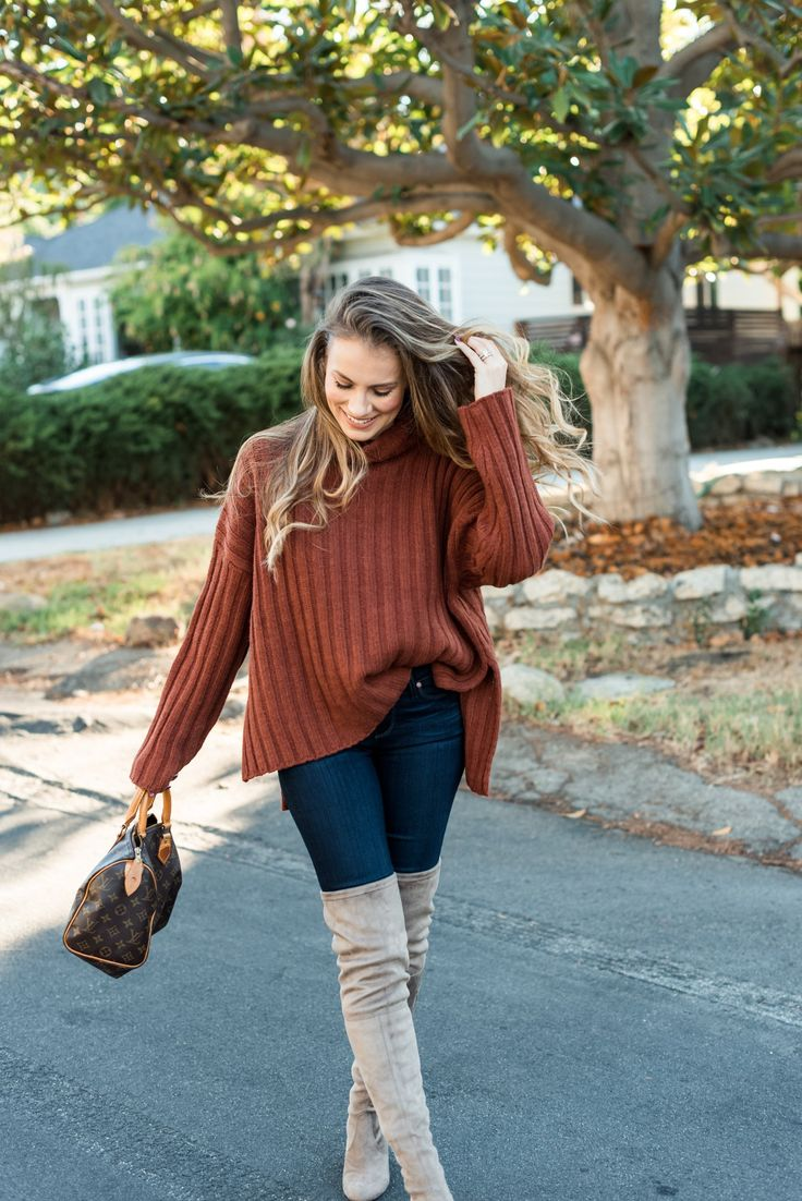 Angela Lanter in over the knee boots and jeans