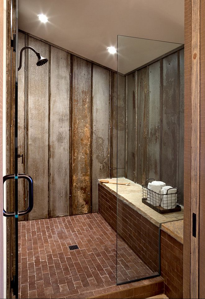 barn shower so cool reclaimed tin roof v channel material lines the shower walls ceramic brick tile adds to the rustic appeal with ultimate durability
