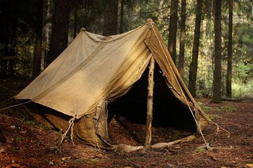old canvas tent in a forest