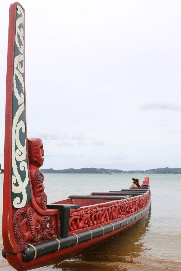 A Maori waka rests on the beach. (Photo by Daniel Lin)