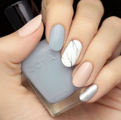 Spice up your typical pastel mani with a marbled accent nail. Keeping it in neutral shades prevents this look from going over the top. See more on House of Lashes' Instagram »