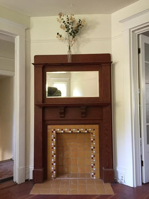 "Antique (around 1900) fireplace corner mantle (52"" W x 84"" H) Stained fir fireplace mantle with bevelled mirror."
