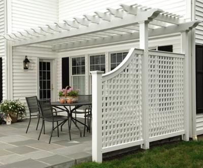 """Alfresco Cellular PVC Pergola - Alfresco dining comes with style and shade for comfort. This hollowvinyl pergola features 5' square post caps and 18' long, 2"""" by 8"""" carrying beams. The 21⁄2"""" horizontal/vertical lattice side panels provide privacy. Vinyl requires minimal maintenance."""