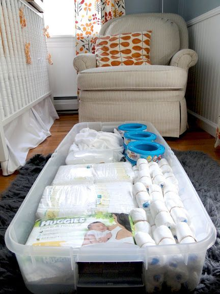 Under crib storage idea - diapers and diaper pail refills. Could also store sheets and towels and blankets.