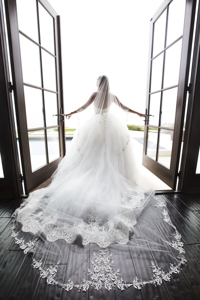 Bride's Lace Cathedral Veil | Photo: Duke Photography. View More: https://www.insideweddings.com/weddings/persian-american-wedding-with-mirror-detailing-in-newport-beach-ca/862/