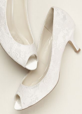 Lace covered mid heeled peep toe.   Materials: White Satin.  Heel: 2 1/4 in.  Imported.